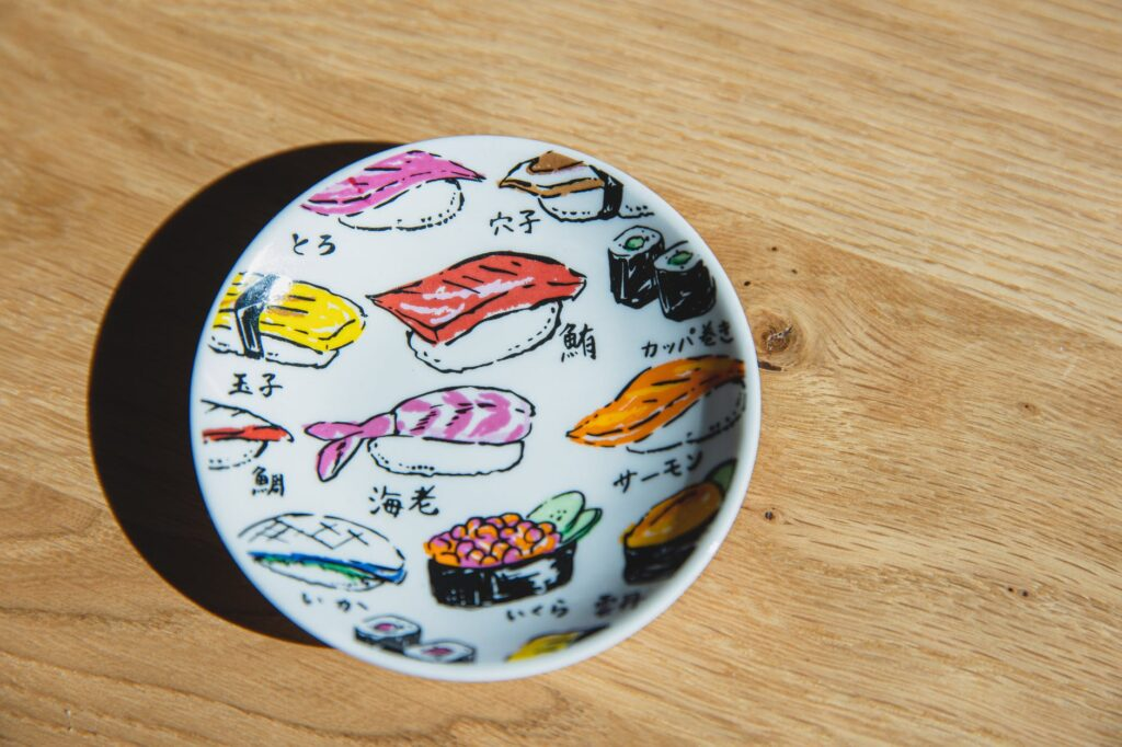 ceramic plate with drawings of sushi